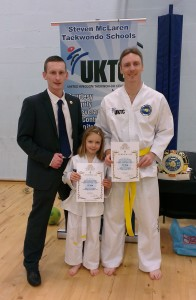 Me and Elisha with our Taekwon-do instructor after our first grading