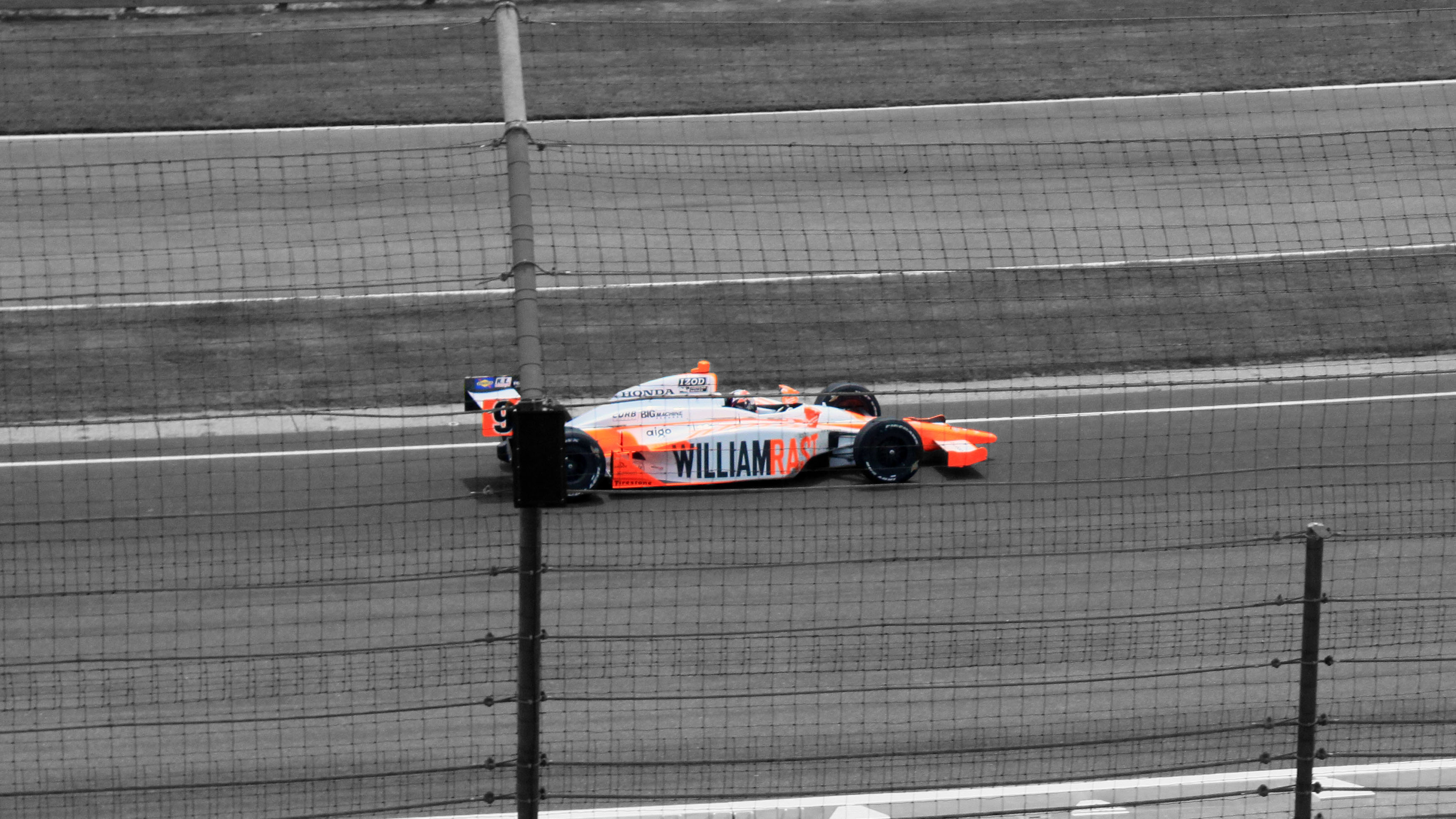 Dan Wheldon's in turn three during his victory lap at the Centennial Indianapolis 500